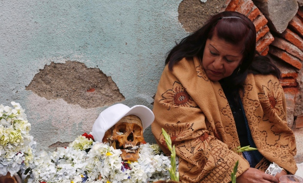 "Bolivians Casual with Death at ""Day of the Skulls"" Festivities Celebration seems ghoulish and garish to Americans"