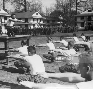 Fort Eustis in 1950; Willie Mays leading exercise yard [Getty Images]
